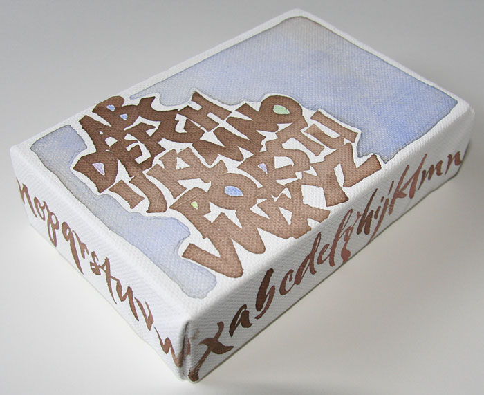 side shot of walnut ink Neuland alphabet by Melissa Dinwiddie