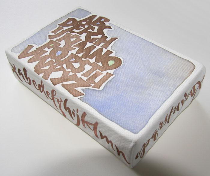 side shot of walnut ink Neuland alphabet by Melissa Dinwiddie