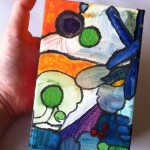 Abstract acrylic painting in my hand, to give a sense of scale.