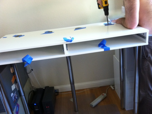Drilling holes in the top of the desk