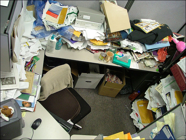 Aerial view of messy cubicle, by Jeffrey Beall on Flickr