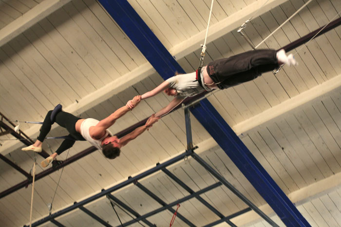 Caught by the catcher! Photo courtesy of Trapeze Arts, Oakland, CA