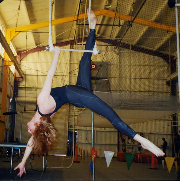 That's me on the static trapeze! You can see the flying trapeze net in the background, to the right of my legs.