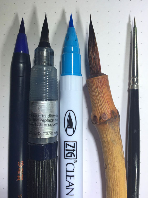<em>Some of my favorite brushes: Akashiya Sai Watercolor Brush Pen; Pentel Colorbrush; Kuretake Zig Clean Color Brush Pen; a handmade brush by the late Keith Lebenzon; Winsor & Newton Series 7 000. The three on the left are all plastic bristles; the two on the right are animal hair.